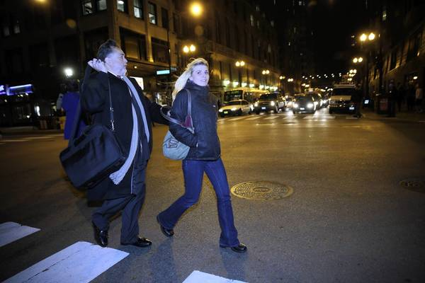 Karolina Obrycka on Tuesday leaves the Dirksen U.S. Courthouse with attorney Gustavo Munoz after a jury awarded her $850,000 in damages in the 2007 beating inflicted by an off-duty Chicago police officer.