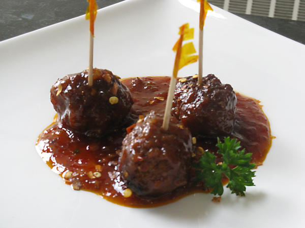 Spicy raspberry enlightenment meatballs are the ideal party appetizer.