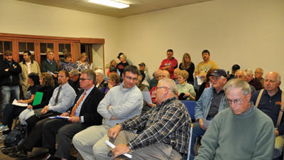 A standing-room-only board meeting ended in a borough vote to ask municipal authority members to resign. A citizens' group asked the board to make a motion to rescind the vote to dissolve the authority. The motion to rescind the vote did not pass. The council voted to keep the authority if all of its members resign.