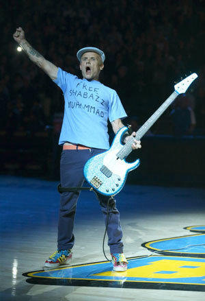 "Flea wears a ""Free Shabazz"" T-Shirt while performing the national anthem before the start of the UCLA-Indiana State game."
