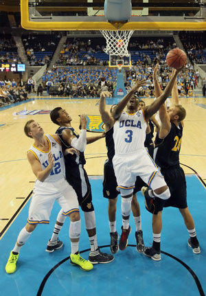 Jordan Adams of UCLA puts back a rebound against UC Irvine.