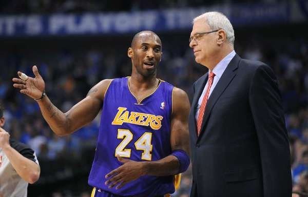 Kobe Bryant and Phil Jackson share a few words in Game 4 of the NBA Western Conference semifinals in 2011.