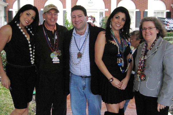 In this file photo from Jan. 30, 2010, from left, Natalie Khawam, David Petraeus, Scott Kelley, Jill Kelley and Holly Petraeus watch the Gasparilla parade in Tampa, Fla. The FBI informed the Pentagon that it had uncovered what may be inappropriate emails between Gen. John Allen, commander of U.S. and international forces in Afghanistan, and Jill Kelley, a 37-year-old Florida socialite.