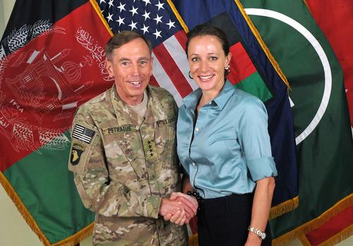 "This July 13, 2011, photo, made available on the International Security Assistance Force's Flickr website, shows Gen. David Petraeus, the former commander of U.S. forces at Afghanistan, shaking hands with Paula Broadwell, co-author of his biography ""All In: The Education of General David Petraeus."""