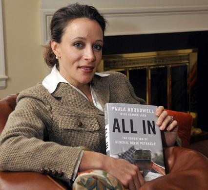 "Paula Broadwell, author of the David Petraeus biography, ""All In,"" poses for photos in Charlotte, N.C., in January. Petraeus, the retired four-star general renowned for taking charge of the military campaigns in Iraq and then Afghanistan, abruptly resigned last week as director of the CIA, admitting to an extramarital affair. Petraeus carried on the affair with Broadwell, according to several U.S. officials with knowledge of the situation."