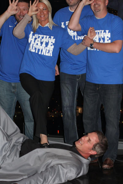 "Kentucky fans pose for photos as they ""stomp"" on former Duke star Christian Laettner, right, at a fundraiser Tuesday before the Duke-Kentucky game in Atlanta."