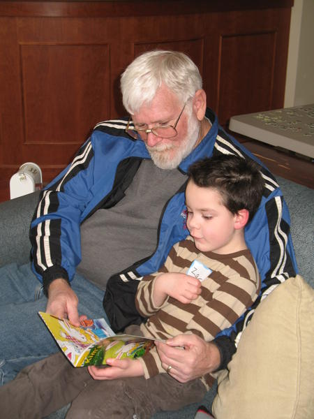 Bob Hartman of East Jordan reads to his grandson, Zacharie, before a support group meeting for Grandparents Raising Grandchildren at the Petoskey Friendship Center. The group is hosting an information session for custodial grandparents on Tuesday, Nov. 27, at the center.
