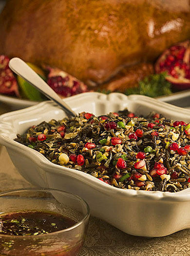 "<strong>Wild rice with pomegranate seeds, hazelnuts</strong><br> <br>  Prep: 20 minutes<br /> Cook: 45 minutes<br /> Servings: 6 to 8<br> <br> <em>Note:</em> Adapted from ""Fine Cooking Thanksgiving Cookbook"" ($12.95). We subbed pomegranate seeds for the original dried cranberries.<br> <br> <strong>Ingredients:</strong><br /> 1 1/2 cups wild rice, rinsed<br /> 1 teaspoon salt<br /> 2 tablespoons unsalted butter<br /> 1/2 cup thinly sliced green onions<br /> 1 tablespoon finely grated orange zest<br /> 3 tablespoons fresh orange juice<br /> 1 cup pomegranate seeds, about 1 medium pomegranate<br /> 1 cup lightly toasted hazelnuts, coarsely chopped<br /> Freshly ground pepper<br> <br>  1. Put wild rice in a large saucepan; cover with water by 1 inch. Add 1/2 teaspoon salt. Heat to a boil. Reduce heat to low, cover and simmer until rice is tender and most grains have popped open, 40-60 minutes. (Add a little more water during cooking if rice gets dry.) Test for tenderness. Pour rice into a strainer; drain well.<br> <br>  2. In the same saucepan, melt butter over medium heat. Add green onions; cook, stirring occasionally, until softened, about 2 minutes. Remove from heat. Add cooked rice, orange zest and juice, pomegranate seeds and hazelnuts; fluff with a fork to blend. Season with remaining 1/2 teaspoon salt and pepper to taste.<br> <br> <strong>Nutrition information:</strong><br /> <em>Per serving (for 8 servings): 257 calories, 12 g fat, 2 g saturated fat, 8 mg cholesterol, 33 g carbohydrates, 7 g protein, 296 mg sodium, 5 g fiber.</em><br> <br> <a href=http://www.chicagotribune.com/features/food/sc-food-1109-pomegranate-turkey-20121114,0,3855165.story> Read the Good Eating story </a>"