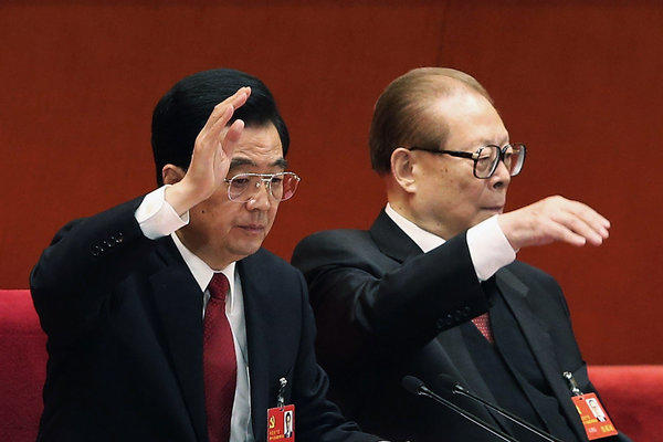 Chinese President Hu Jintao, left, and former President Jiang Zemin vote Wednesday at the closing of the 18th Communist Party Congress at the Great Hall of the People in Beijing.