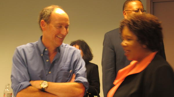 Ron Gunzburger chats with County Administrator Bertha Henry on Tuesday.