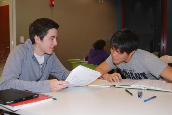 Two students do homework at the new Teen Center at Schaumburg Township District Library.