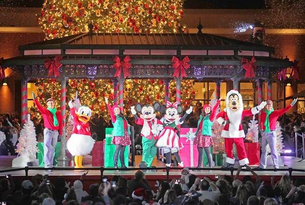 A performance starring Disney characters, Mickey and Minnie Mouse, Donald Duck and Goofy, put on a show during the annual Fashion Island Christmas tree lighting ceremony in Newport Beach on Tuesday.