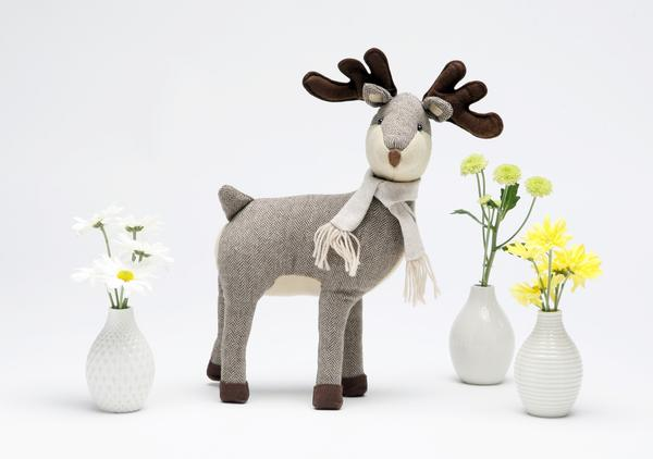 For those who like holiday decor where the cute factor is kept in check, Kohl's has this 19-inch-tall St. Nicholas Square deer, smartly dressed in a herringbone coat and coordinating scarf. Regular price: $19.99. We bought ours on sale for $13.49. Another surprise at Kohl's: Elle Decor-branded decorative accessories that interpret trends for budget buyers. A set of three ceramic vases -- coordinated in color but contrasting in pattern -- are regularly priced at $29.99. We bought ours on sale for $11.69.