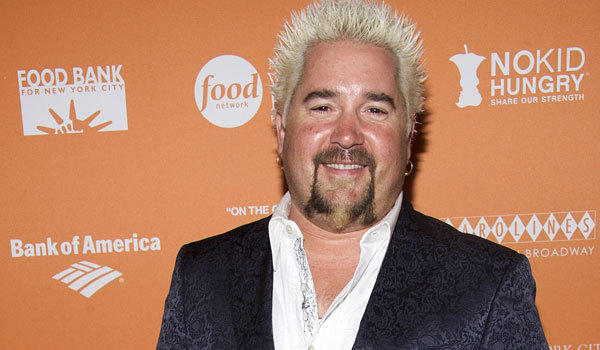 "Guy Fieri, the host of ""Diners, Drive-Ins and Dives,"" gets poor marks from the New York Times at his new restaurant."