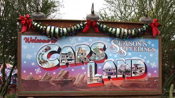 "The new holiday billboard at the entrance to Cars Land in Disney California Adventure welcomes visitors with the slogan, ""Seasons Speedings."""