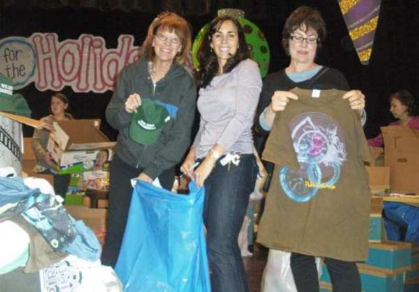 Packing gift bags for last year's Holiday Basket program are Burbank Coordinating Council volunteers, from left, Council member Emily Gabel-Luddy, Cindy Giraldo and Sharon Springer.