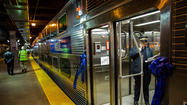 "Metra on Wednesday unveiled the first four of its new ""Highliner"" cars that will go into service later this week on the Electric District Line."