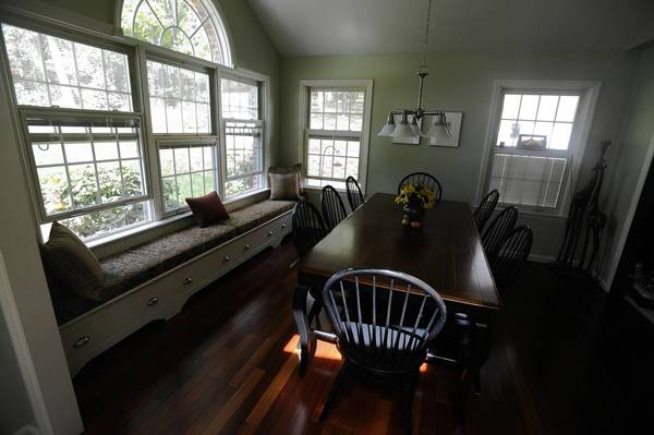 Window seats lend a new look to an old house.