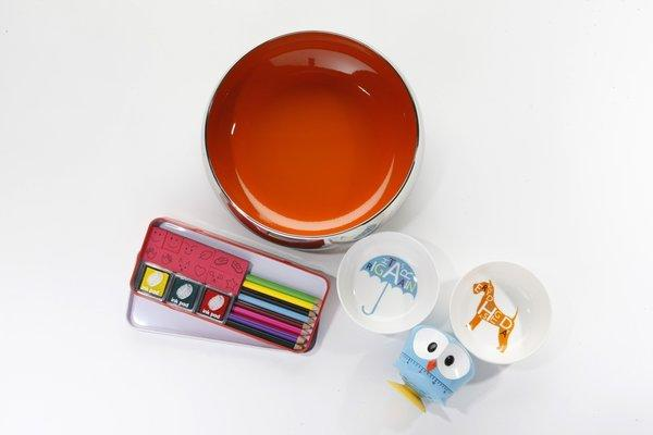 "JCPenney also has a playful new Royal Doulton collection that includes stainless steel serving bowls with pops of color inside. The 9-inch-diameter orange bowl shown here was $40. The same collection includes ceramic plates and bowls with punchy graphics, including the 4.25-inch-diameter ""Every Dog Has Its Day"" and ""Right As Rain"" candy bowls pictured here, $25 for a set of two. JCPenney also has a Museum of Modern Art mini shop, where we found an owl kitchen timer from hip housewares designer Kikkerland, $15, as well as an old-school fingerprint art set so we can channel Ed Emberley, $12."