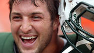 "New York Jets quarterback Tim Tebow will speak at an event in March at Liberty University's Wildfire ""Men's Impact Weekend."""