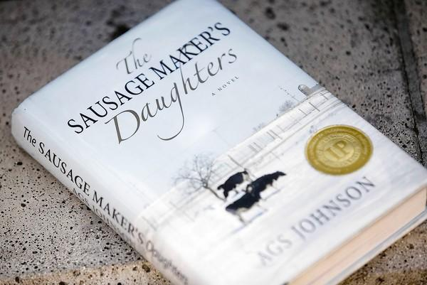 "A.G.S. Johnson is the author of ""The Sausage Maker's Daughters,""  a mystery-courtroom drama set in the Vietnam War era."