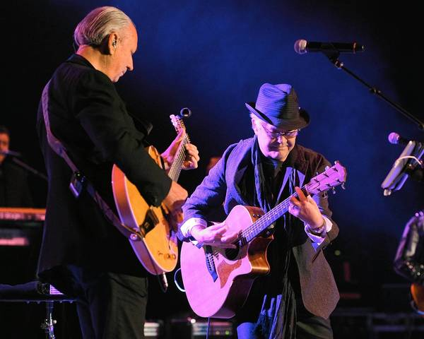 Michael Nesmith, left, and Micky Dolenz of The Monkees perform at The Greek Theatre in Los Angeles.