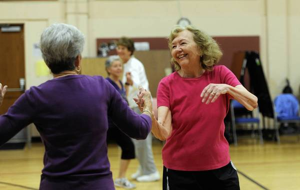 """Georgia Heckler, left, and Jeannette Marx have fun in the """"Gotta Dance"""" class at the Bykota Senior Center."""