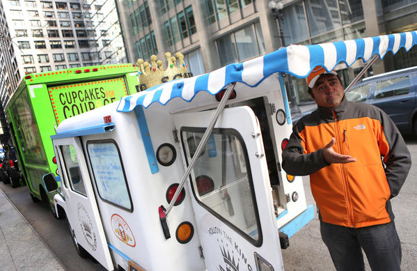 Greg Burke, owner and operator, of Chicago Schnitzel King, stands next to his food truck after he announced a lawsuit over city restrictions on food trucks.