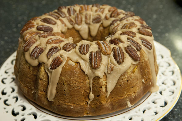<b>Cranberry apple pumpkin bundt cake <br><br> </b><i> 3/4 cup finely chopped pecans<br>  1 1/2 cups peeled and diced Granny Smith apples<br>  2 tablespoons butter, melted<br>  1/2 cup finely chopped sweetened dried cranberries <br> 1/2 cup firmly packed light brown sugar <br> 3 tablespoons, plus 3 cups all-purpose flour<br>  2 cups sugar<br>  1 cup butter, softened<br>  4 large eggs<br>  1 (15-ounce) can pumpkin puree<br>  1 tablespoon vanilla extract<br>  2 teaspoons baking powder<br>  2 teaspoons pumpkin pie spice<br>  1/2 teaspoon baking soda<br>  Maple glaze (See recipe)<br>  Sugared pecans (See recipe)</i><br><br>  1 Preheat oven to 350 degrees. Grease and flour at 12-cup bundt pan. Place pecans in a shallow pan and bake 6 to 8 minutes, or until roasted, stirring halfway through. Cool 15 minutes. Reduce heat to 325 degrees. <br><br> 2 Toss diced apples in melted butter to coat in a medium bowl; add cranberries, brown sugar, 3 tablespoons flour and toasted pecans. Toss until well blended.<br><br>  3 Beat sugar and softened butter at medium speed in a large bowl with an electric mixer until light and fluffy. Add eggs, one at a time, beating just until smooth. Add pumpkin and vanilla, beat just until blended. <br><br> 4 In another large bowl, stir together remaining 3 cups flour, baking powder, pumpkin pie spice, and baking soda. Gradually add flour mixture to egg mixture, beating at low speed just until blended after each addition.<br><br>  5 Spoon half the batter into prepared pan. Spoon apple mixture over batter, leaving a 1/2-inch border around outer edge. Spoon remaining batter over apple mixture. Bake in 325-degree oven for 1 hour and 20 minutes, or until a wooden pick inserted in the center of the cake comes out clean. Cool in a pan on a wire rack 15 minutes. Remove from pan to wire rack; cool completely, about 2 hours. <br><br> 6 Once cake has cooled, spoon cooled Maple glaze over cake. Arrange Sugared pecans on top and serve. <br><br> Serves 12. <br><br> Nutrition information per serving: 663 calories, 42% calories from fat, 31 g fat, 14 g saturated fat, 115 mg cholesterol, 92 g carbohydrates, 7 g protein, 145 mg sodium, 3 g fiber <br><br>  <b>Maple glaze<br><br> </b><i> 1/2 cup pure maple syrup<br>  2 tablespoons butter<br>  1 tablespoon milk<br>  1 teaspoon vanilla <br> 1 cup confectioners' sugar <br></i> 1 In a small saucepan, combine maple syrup, butter and milk and bring to a boil over medium-high heat, stirring constantly, about 2 minutes. <br> 2 Remove from heat, whisk in vanilla. Gradually whisk in confectioners' sugar until smooth, 3 to 5 minutes until mixture begins to thicken and cool slightly. <br><br> Makes about 1 cup. <br><br> Nutrition information per tablespoon: 69 calories, 18% calories from fat, 1 g fat, 1 g saturated fat, 4 mg cholesterol, 14 g carbohydrates, 0 g protein, 2 mg sodium, 0 g fiber <br><br><b> Sugared pecans <br><br></b><i> 1 cup pecan halves and pieces <br> 2 tablespoons butter, melted <br> 2 tablespoons sugar <br><br></i> Preheat oven to 350 degrees. Stir together pecans and butter in a small bowl. Spread in a single layer in a 13-by-9-inch baking pan. Bake 12 to 15 minutes, or until toasted, stirring halfway through. Remove from oven, toss with sugar. Cool completely, about 20 minutes. <br><br> Makes 1 cup. <br><br> Nutrition information per tablespoon: 66 calories, 86% calories from fat, 6 g fat, 1 g saturated fat, 4 mg cholesterol, 3 g carbohydrates, 1 g protein, 0 mg sodium, 1 g fiber