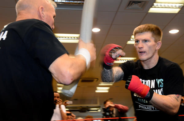 Ricky Hatton works with trainer Bob Shannon during a session Wednesday in England.