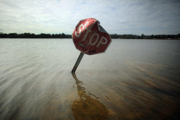 Floodwaters surround a stop sign in Bay Head, N.J.