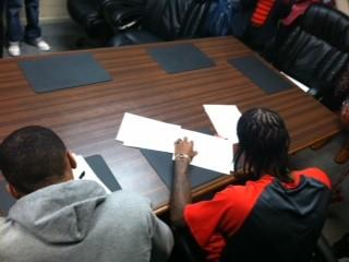 Jordan Baker (l) and Anthony Barber sign their letters-of-intent.