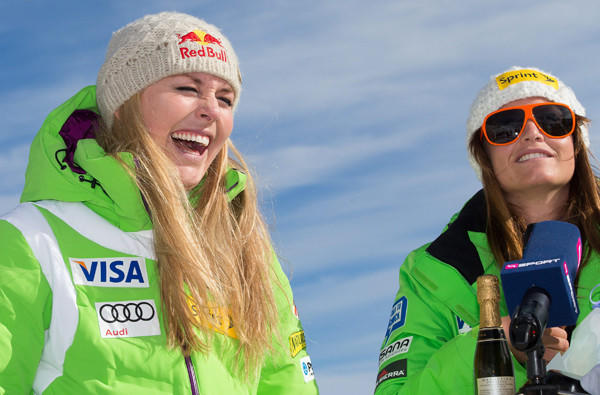Lindsey Vonn and Julie Mancuso share a laugh during a news conference in Austria before the World Cup season opener.