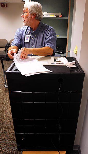 Dean Robucci scans provisional ballots from last week's election Wednesday during Washington County Election Board's countiung of the voting documents. Officials said there were more than 1,000 provisional ballots.