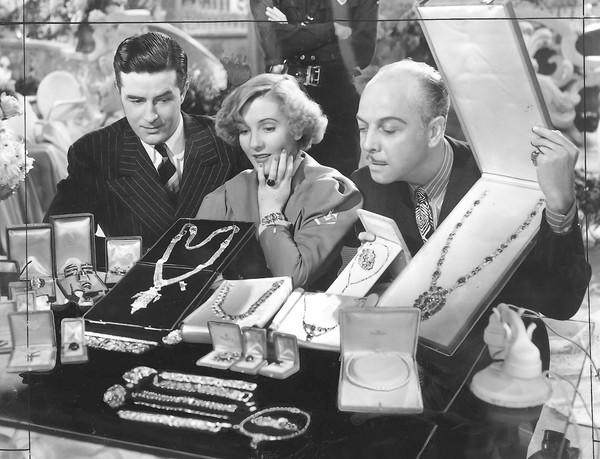 """Easy LIving"" with Ray Milland, left, and Jean Arthur. That's director Mitchell Leisen at right."