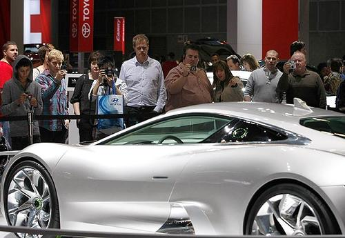 Auto fans gather to view and photograph the Jaguar C-X75 during the first day of the 2010 Los Angeles Auto Show at the Los Angeles Convention Center.