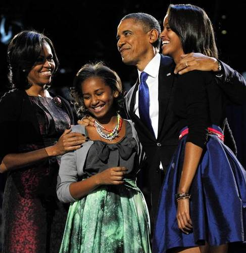 President Barack Obama celebrates his re-election with first lady Michelle Obama, left, and daughters Sasha, second left, and Malia, at McCormick Place in Chicago.