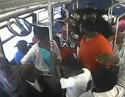 Three suspects seen on surveillance video wearing a white T-shirt, red shirt and black shirt are accused of beating and robbing a teenage bus rider