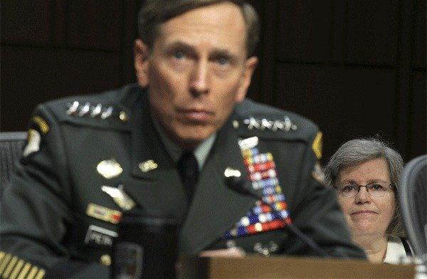 David Petraeus submitted his resignation as director of the CIA on Nov. 9 citing an extramarital affair. Above: Petraeus is seen during a confirmation hearing before the Senate on June 23, 2011 as his wife Holly Petraeus, looks on.