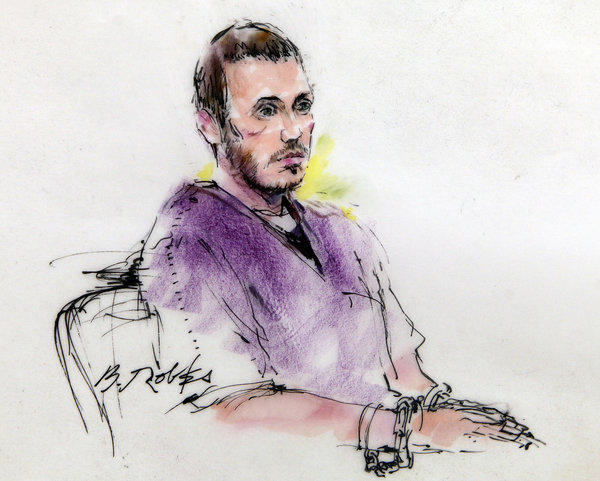 James E. Holmes, shown in a courtroom sketch from a court hearing in September, is accused of killing 12 during a shooting rampage at a movie theater in Aurora, Colo.