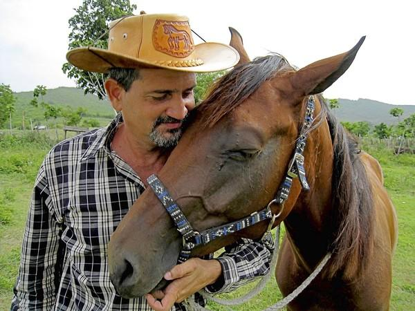 "Julio Munoz, a horse whisperer with Luna de Miel in Trinidad, Cuba, has wtinessed many changes in the town. ""I am a survivor. ... I am incredibly happy."""