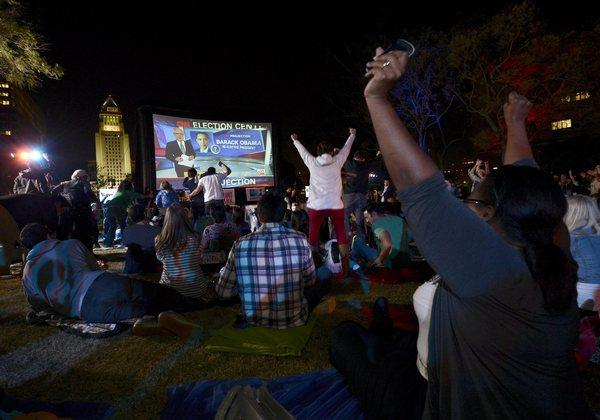 "Supporters cheer as they watch CNN project the re-election of President Obama during ""Park Your Politics"" party at Grand Park in downtown Los Angeles."