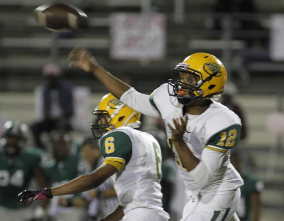 Lake Minneola's Andrew Jones throws a pass during a 43-25 loss to host Evans on Friday.