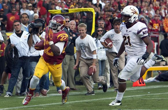 USC running back Curtis McNeal gets past Arizona State safety Chris Young to score the final touchdown of the game on Saturday.