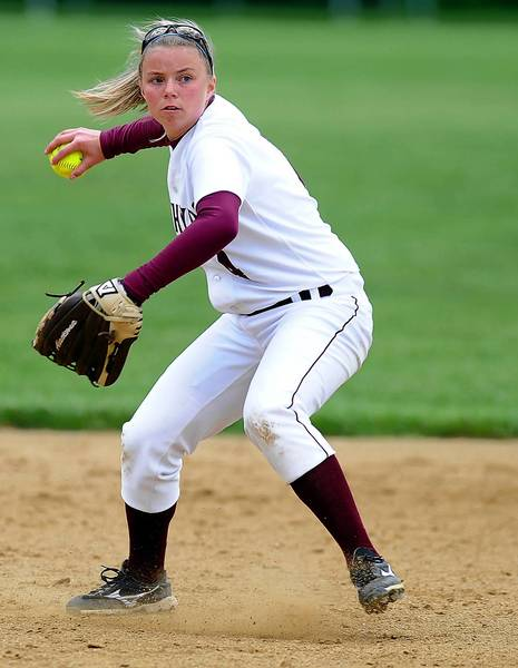 Whitehall's SS Madison Kelly (4) throws to first base.