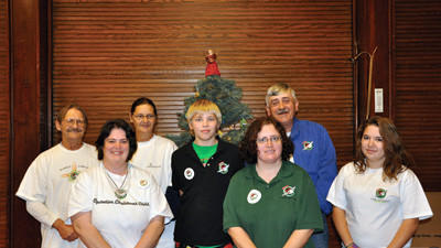 Operation Christmas Child volunteers at Meyersdale First United Methodist Church pose with donations collected from church members and placed under the Christmas tree. From left: Bill Snyder, Ruth Ann Faner, Barb Snyder, Derick Shroyer, Debby Faner, Coordinator Art Faner and Tressa Price.