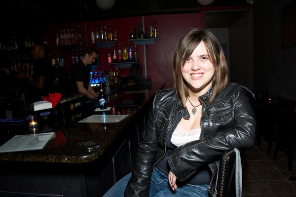 <b>Carrie Peterson, 26, lawyer</b><br><br> <b>What are you drinking and why?</b> There's a special tonight, so I had a Tom Collins and a kamikaze.<br><br>  <b>What are you most looking forward to about the upcoming holidays?</b> Probably spending time with family. Family get-togethers, meals and stuff.<br><br> <b>What's your favorite holiday food?</b> Stuffing. It has to be stuffing. I¿m a carb addict, so I can¿t resist bread covered in lots of fat and stuff.