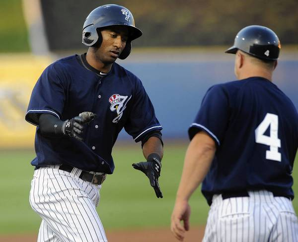 The Scranton/Wilkes-Barre Yankees' Eduardo Nunez rounds the bases after hitting a home run at Coca-Cola Park in August.