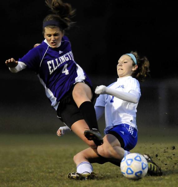 Burlington, CT 11/14/12 Bailey Pace of Lewis Mills (R) tackles Olivia Kosilla of Ellington (L) during the first half of their Class M girls soccer quarterfinal Wednesday night at Nassahegan Field in Burlington. Lewis mills advanced with a 1-0 victoy on a goal by Mackenzie Bergstrom in the second half. Photo by JOHN WOIKE   woike@courant.com