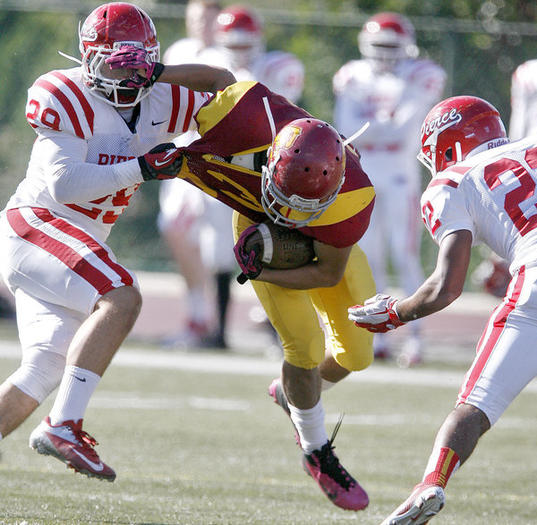 GCC's Walter Moctezuma is tackled during a loss to L.A. Pierce in the final game of the season.